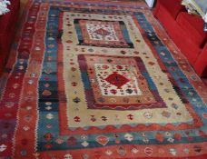 A Middle Eastern woollen rug, with geometrical patterns, in bands, 345cm x 245cm
