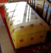 A Victorian mahogany ottoman, stuffed over top and upholstered sides, 45cm high, 125cm wide, 6 3cm