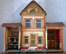 A 19th century scratch built two storey dolls house, central removal front, enclosing fitted