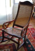 A 19th century rocker chair, bergere back and seat, scroll arms, c.1870