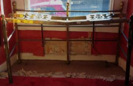 A 19th century folding brass and iron hearth rack, with brass sliding pierced plates, 76cm high,