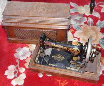 A Singer manual sewing machine, oak case, c.1910