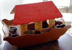 A mid 20th century wooden Noah's Arc, 39cm high, 65cm wide; a two storey dolls house, 44cm high,