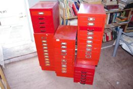 Six red metal filing cabinets, various sizes, the largest 70cm x 28cm x 41cm