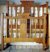 An Art Nouveau double bed head foot board, 125cm wide, 139cm high, c.1915