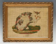 A 19th century Berlin woolwork picture, of a cat, 22cm x 30cm, c.1850, gilt frame