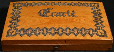 A 19th century French playing card box, hinged cover decorated with cut-steel pinwork and