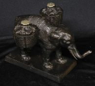 A 19th century cast iron novelty inkstand, as an elephant laden with baskets, rectangular base, 19cm