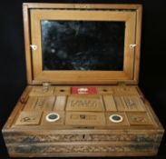 A 19th century Indian sandalwood sarcophagus combination work and writing box, profusely carved with