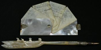 A 19th century mother of pearl aide memoir, 4.5cm long, c.1890; a Chinese mother of pearl pen, the