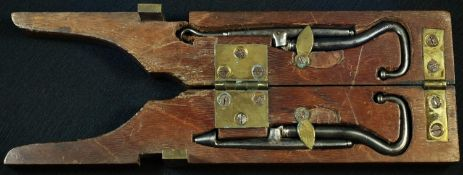 A 19th century mahogany combination boot jack and pull suite, the brass flush-catch enclosing a
