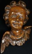 A 19th century Italian limewood carving, of a putto, 17cm long, dated to verso 1865