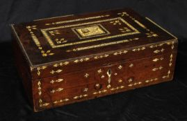 A 19th century Indian hardwood and ivory marquetry rectangular box, hinged cover centred by a