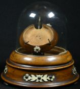 A 19th century pocket watch stand, hinged glass dome, turned base, applied with cut-card work, bun