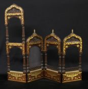 A 19th century Orientalist mahogany and brass marquetry quadriptych graduating photograph frame,