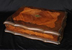 A 19th century French kingwood and rosewood shaped rectangular gaming box, hinged quarter-veneered