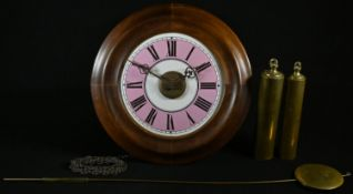 A 19th century postman's alarm clock, 17.5cm pink and white enamel dial inscribed with Roman