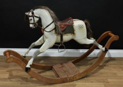 A good Edwardian dappled grey rocking horse on bow rockers, the carved, gesso and painted horse with