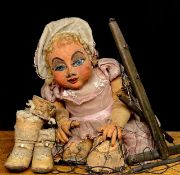 Puppetry - a mid-20th century large marionette puppet, in the form of a baby girl, sculpted and