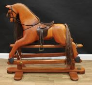 A 20th century House of Marbles (Devon) carved hardwood rocking horse on safety stand, carved