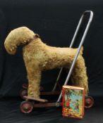 Toys - a push along dog; a Chad valley money box (2)