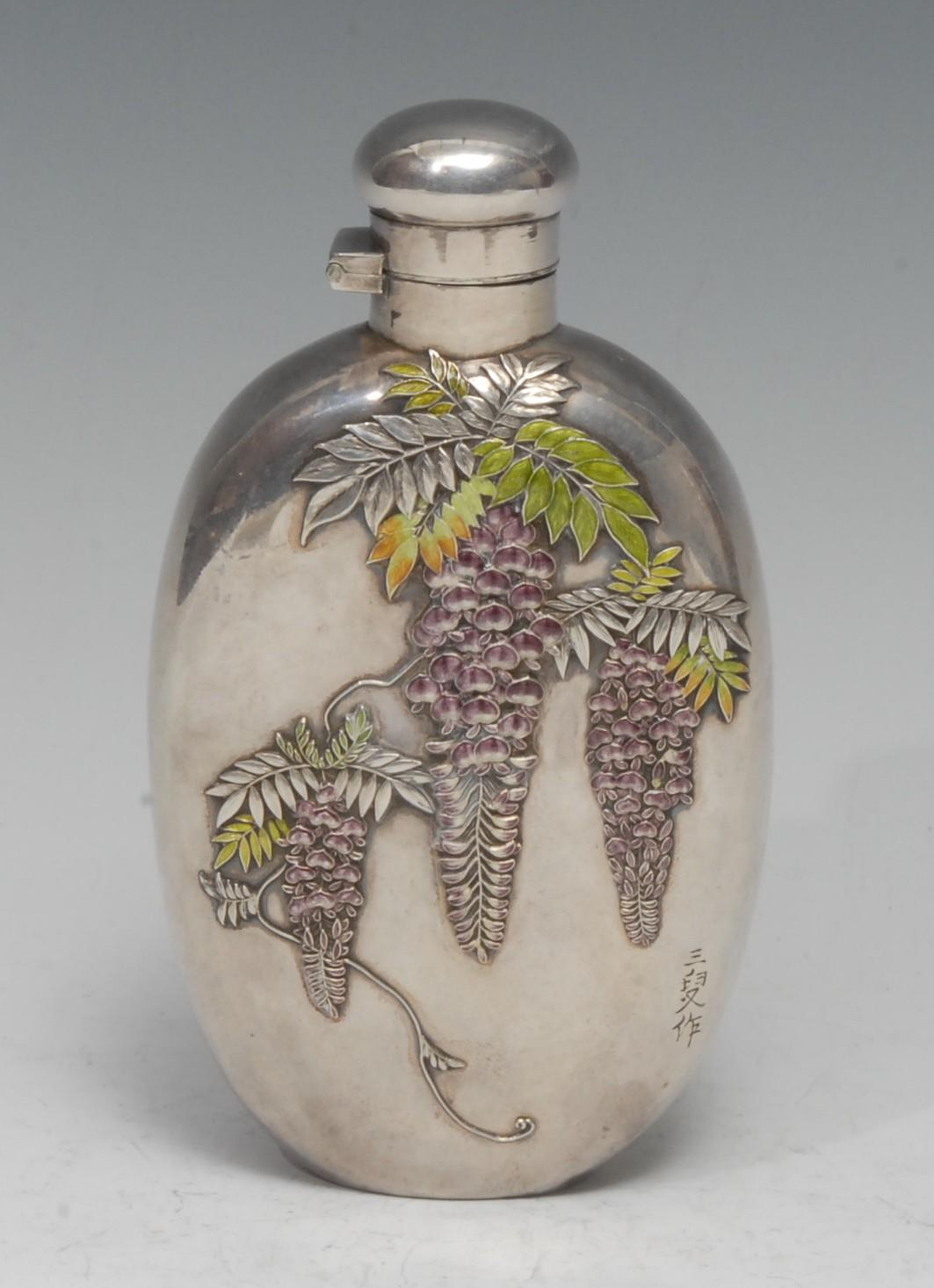 A Japanese silver and enamel oval hip flask, applied and decorated in polychrome with wisteria,