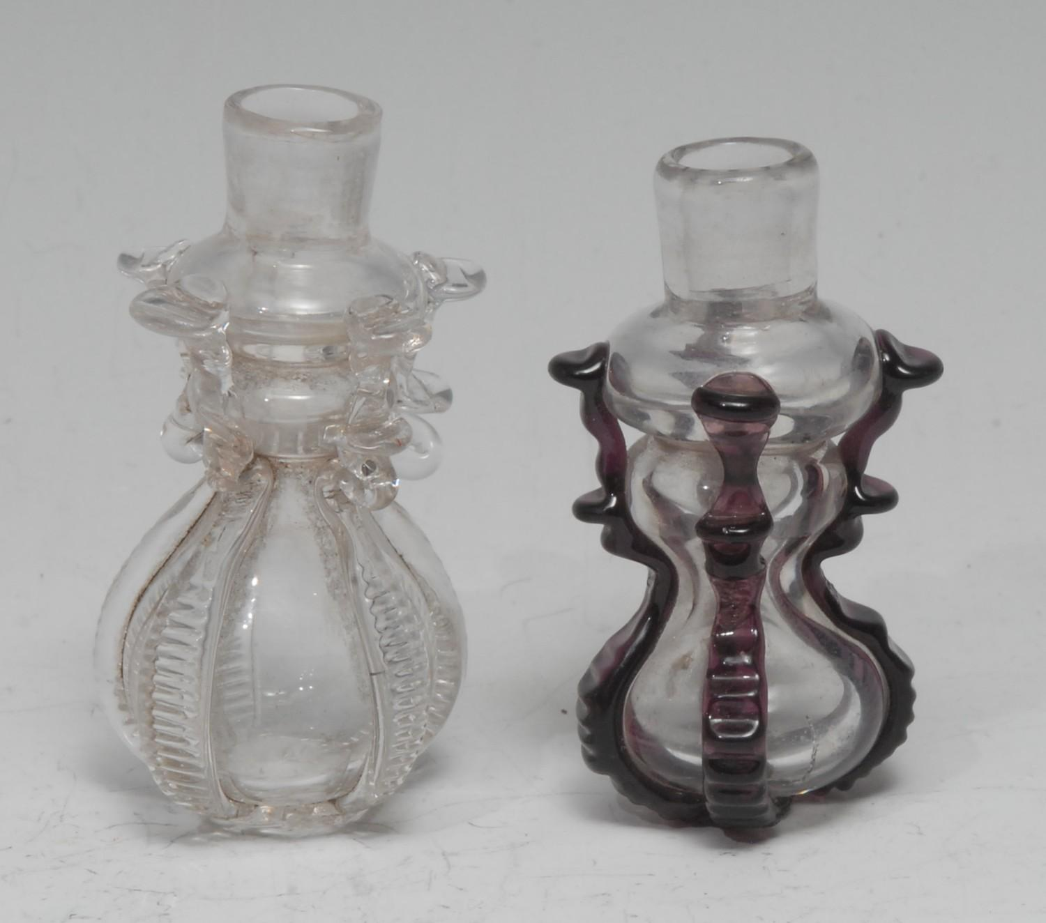 A small 18th century cruciform glass flask or phial, hourglass reservoir applied with purple lugs,