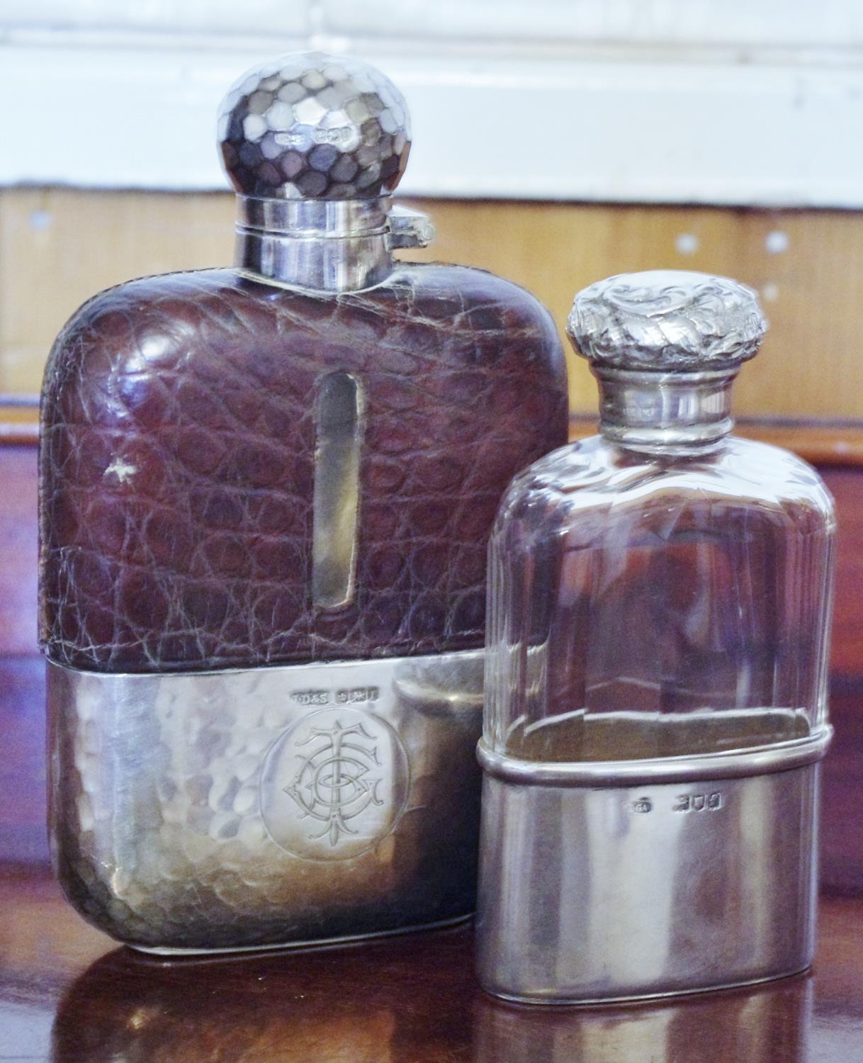 A late Victorian silver and glass hip flask, screw-on cover, the cup base gilt, 11cm high, maker?s