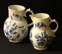 A Worcester Dutch jug, Cabbage Leaf Jug Floral pattern, the baluster moulded in relief with