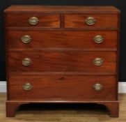 A Regency mahogany chest, flush rectangular top above two short and three long graduated