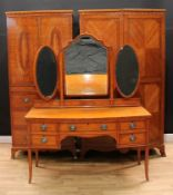 A Waring & Gillow Sheraton Revival satinwood three-piece bedroom suite, comprising a dressing table,