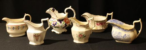 A collection of six early 19th century and later English porcelain cream jugs, various shapes,