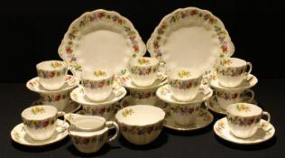 A Royal Crown Derby Melody pattern tea service for twelve comprising two cake plates, side plates,