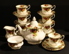 A Royal Albert Old Country Roses tea service for six; a similar trio
