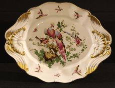 A Sampson shaped oval serving plate, painted with fanciful birds, moulded with shells and scrolls,