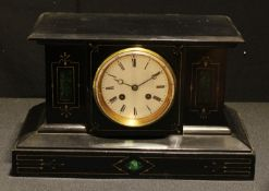 A Victorian slate mantel clock, the white enamelled dial with Roman numerals, twin winding holes,