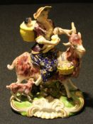 A Derby figural group, The Welch Tailor's Wife, typically modelled, painted in polychrome and picked