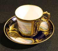 A Continental porcelain cabinet cup and saucer, painted with gentlemen on horseback and coastal