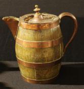 A 19th century copper-coopered oak barrel-shaped flagon or jug, knop finial, scroll handle, 32cm