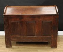 An 18th century oak ark, gabled top, the front with three raised and fielded panels, stile feet,