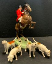 A Beswick model Rearing Huntsman, model 868, four assorted hounds (5)