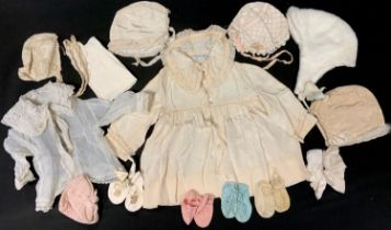 An early 1900's Debenhams & Freebody toddlers silk dress, with faux mother of pearl buttons,