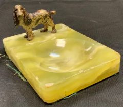 A painted metal figure of a spaniel dog standing, mounted on a green onyx base, 74mm high, 14cm