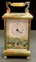 A Spode brass carriage clock with hand painted picnic scene, ceramic side panels. Boxed. 19.5cm