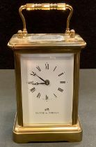 A carriage clock by Matthew Norman, with white enamel dial with Roman numerals and makers name,