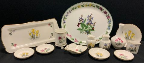 A Royal Worcester Herbs pattern oval platter, Alpine Flowers pattern shaped rectangular tray, vases,