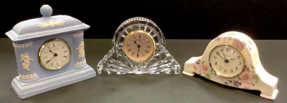 A Waterford Crystal mantel clock; a Wedgwood Jasperware mantel clock; a Blandford ceramic mantel