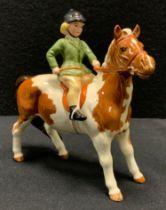 A Beswick model Girl on Pony, 1499, Skewbald, printed marks