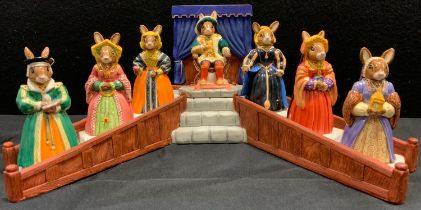 A Royal Doulton Bunnykins Tudor Collection Henry VIII and his wives set on display stand, inc Anne