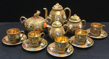 A Japanese Satsuma exportware coffee set decorated with traditional deities and figure, etc qty